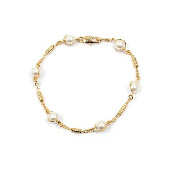 Bracelet tubes et 6 perles en plaqué or